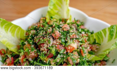 A Bowl Of Delicious Fresh Tabbouleh (tabbouli) Salad With Parsley, Mint, Tomato, Onion, Olive Oil An