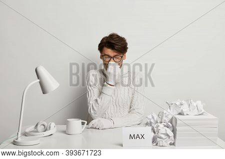 Photo Of Man Freelancer Or Office Worker Suffers From Running Nose, Rubs Nose With Handkerchief, Wor