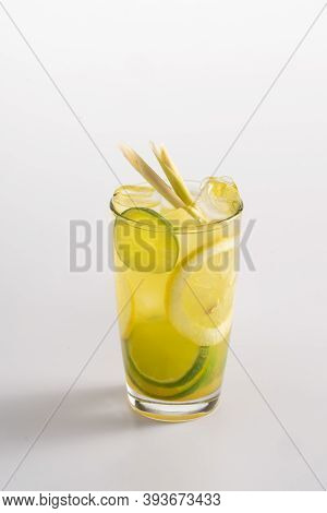 Summer Refreshing Cocktail With Ice And Alcohol. Sparkling Water, Match Syrup, Mango Syrup, Lemon Ju