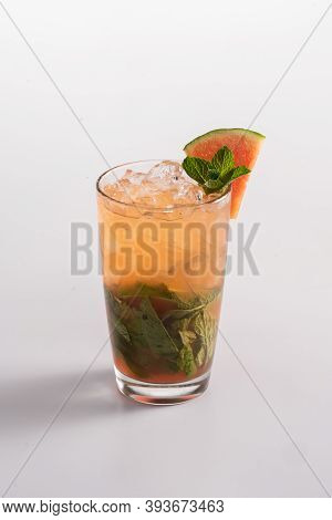 Summer Refreshing Cocktail With Ice. Light Rum, Sugar Syrup, Multifruit Juice, Watermelon Syrup.