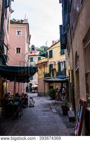 Monterosso Al Mare, Italy - July 8, 2017: Tourists In A Restaurant In Monterosso Al Mare Old Town On