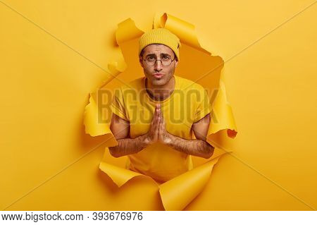 Please, Dont Leave Me Alone In Difficult Situation. Sad Unhappy Man Youngster Keeps Hands In Praying