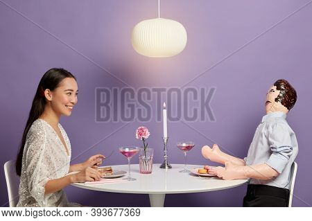 Horizontal Shot Of Happy Korean Woman Enjoys Time With Unreal Imaginary Man, Dreams About Perfect Re