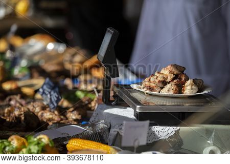 Fried Kebabs In A Plate On The Scales. Street Food.