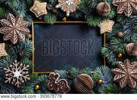 Christmas Composition. Frame With Gingerbread, Pine Branches, Wooden And Paper Christmas Decorations