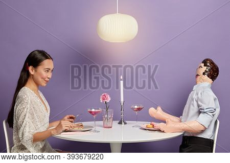 Photo Of Asian Woman Has Talk With Unreal Boyfriend, Pretends Having Romantic Dinner With Gentleman,