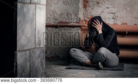 The Concept Of Drug Addiction And Homelessness. A Depressed And Hopeless Woman Sits After Using Drug