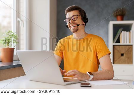 Happy Laughing Man Wearing Headset Communicate By Conference Video Call With Friends Or Family. Free