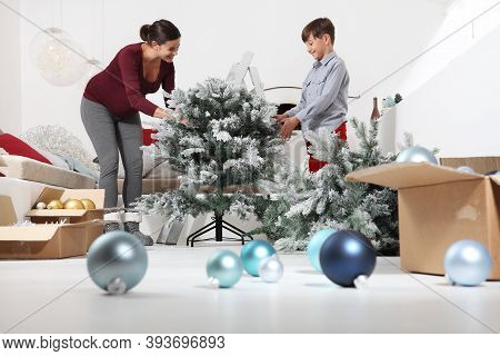 Merry Christmas, Happy Pregnant Woman And Her Child Prepare The Christmas Tree, Open The Boxes Of Ba