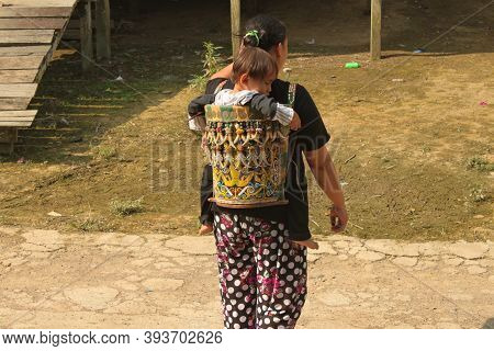 Indonesia, Borneo - October 1st 2015 - Traditional Decorated Baby Carrier Used By Dayak People On Bo