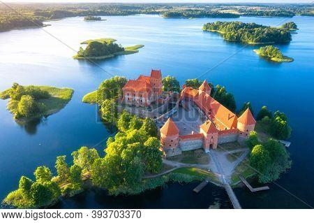 Summer Sunrise. Aerial View Of Historical Sightseeing Lithuania. Famous Trakai Castle. Beautiful Tou