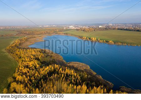 Autumn Panorama. Aerial View On Woods, Lake And Town. Sunny Autumn Day Above Woods And Lake. Beautif