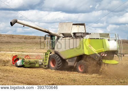 Agriculture Concept. Summer Harvest. Agriculture Machine Works In Field. Harvesting Wheat. Combine H