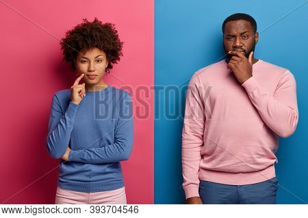 Serious Dark Skinned Female And Male Have Deep Thoughts, Pensive Look, Make Decision Or Think Over P
