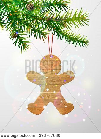 Christmas Tree Branch With Gingerbread Man Of Wood. Christmas Ornament Of Wooden Planks Hanging On P