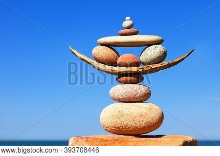 Rock Zen Pyramid Of Colorful Pebbles On A Beach On The Background Of The Sea. Concept Of Life Balanc