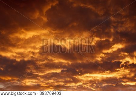 Colorful Dramatic Sky With Orange Clouds At Sunset. Soft Focus
