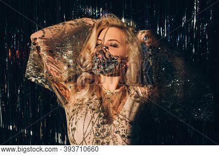 Carnival Fashion. Pandemic Beauty. Festive Look. Christmas 2021 Celebration. Mysterious Blonde Woman