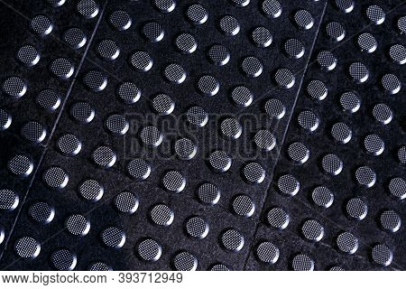 Tactile Gray Tiles On The Sidewalk. Close Up. Metal Tactile Indicators