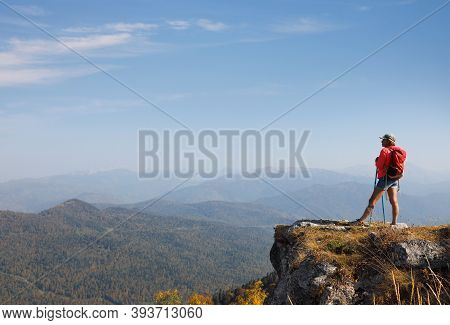 Girl On Top Of A Hill In Silence And Loneliness Admires A Tranquil Natural Landscape In Search Of A