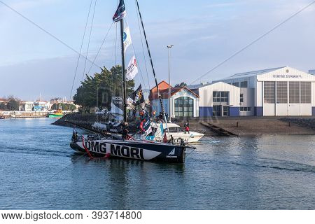 LES SABLES D\'OLONNE, FRANCE - NOVEMBER 08, 2020: Kojiro Shiraishi boat (DMG Mori) in the channel for the start of the Vendee Globe 2020 on November 08,2020. in Les Sables d\'Olonne, France.