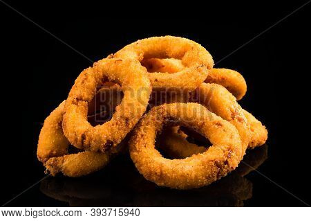 Deep Fried Calamari Rings Isolated On Black, Squid Rings Fries