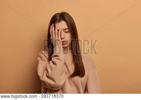 I Cannot Look At This Mess. Frustrated Tired Woman Makes Facepalm, Stands Displeased And Unintereste