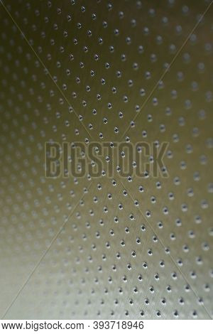 Industrial Vertical Background In Olive Or Bronze Color. Perforated Metal Surface With Many Holes. T