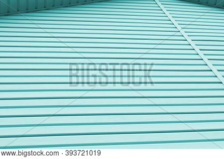Striped Plastic Siding Surface. Construction And Renovation Of Buildings. Tinted Light Aquamarine Or