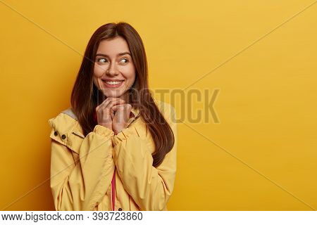 Adorable Cheerful Woman Has Gentle Smile, Recalls Heartwarming Situation In Life, Keeps Hands Under