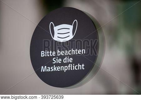 Info Sign In A German City With German Text. Bitte Beachten Sie Die Maskenpflicht. Please Note The M
