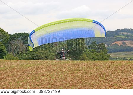 Paramotor Trike Launching In A Farm Field