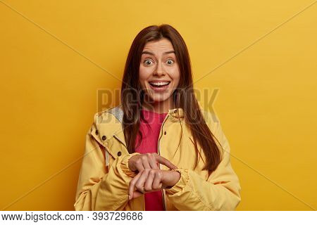 Your Time Is Running Out. Positive Female Student Points At Wrist, On Invisible Watch, Being Very Pu