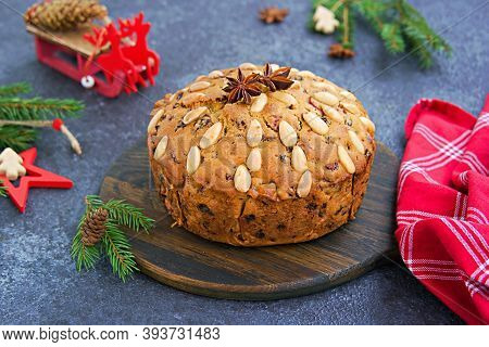 A Traditional Scottish Christmas Fruit Dundee Cake With A Mix Of Dried Fruits, Decorated With Peeled