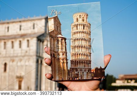 Pisa, Province Of Pisa/ Italy - September 08  2014 Year: Leaning Tower Of Pisa On A Postcard In Hand