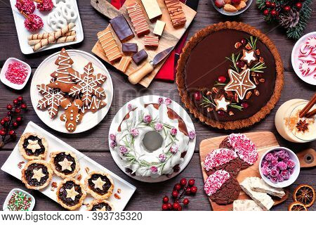Variety Of Christmas Holiday Desserts And Sweets. Above View Table Scene Over A Wood Background. Bun