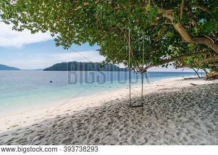 Scenic View Of Beautiful Sai Khao (white Sand) Beach With Swing In Ra Wi Island, Southern Of Thailan