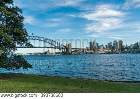 Sydney Harbor Bridge With Sydney Cbd Downtown Skyline, In The Afternoon, New South Wales, Australia.