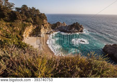 Mcway Falls - Pacific Coast Highway In Big Sur, California, Usa In The Afternoon With Wild Flowers