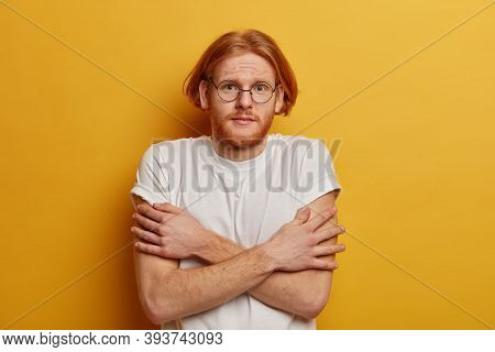 Unhappy Youngster With Bob Hair, Ginger Beard, Keeps Hands Crossed Over Body, Trembles From Cold, Ha
