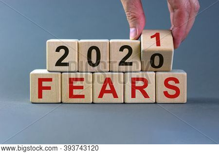 Business Concept Of Planning 2021. Male Hand Flips A Wooden Cube And Changes The Inscription 'fears