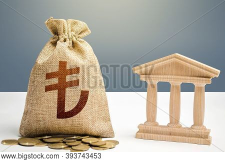Turkish Lira Money Bag And Bank / Government Building. Budgeting, National Financial System. Monetar