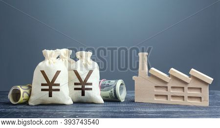 Yen Yuan Money Bags And Industrial Factory Plant. Investments In Production And Energy Industry. Sub
