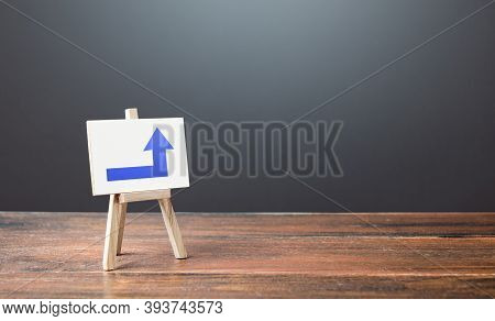 Easel With A Blue Right Up Arrow. Direction To Go Around. Bypassing Obstacles And Solving Problems.