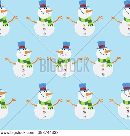 Happy Snowman Made Of Paper On A Blue Background, Pattern. Christmas Card. Snowmen Are Taken From A