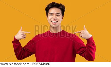 Choose An Pick Me. Self-assured And Charismatic Asian Man Pointing At Self, Wearing Red Sweater. Ego