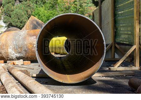 Large Water Pipe Outside. Pipe To Replace The Site. Installation Of A Large Water Pipe.