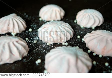 Pink Marshmallow On A Dark Background. White And Pink Sweet Homemade Marshmallows Or Zephyr. The Vie