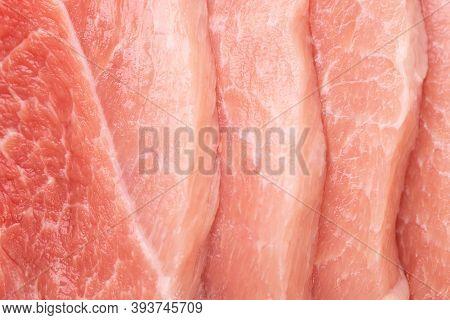 Pieces Of Sliced Raw Pork Close-up. Pork Meat Background. Pork Meat Macro Shot.