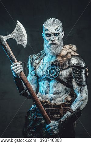 Winter Undead Warrior With Pale Skin And Blue Eyes Dressed In Armour With Fur Holding Two Handed Axe